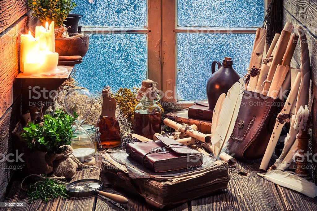 Vintage witch workshop full of scrolls and recipe stock photo