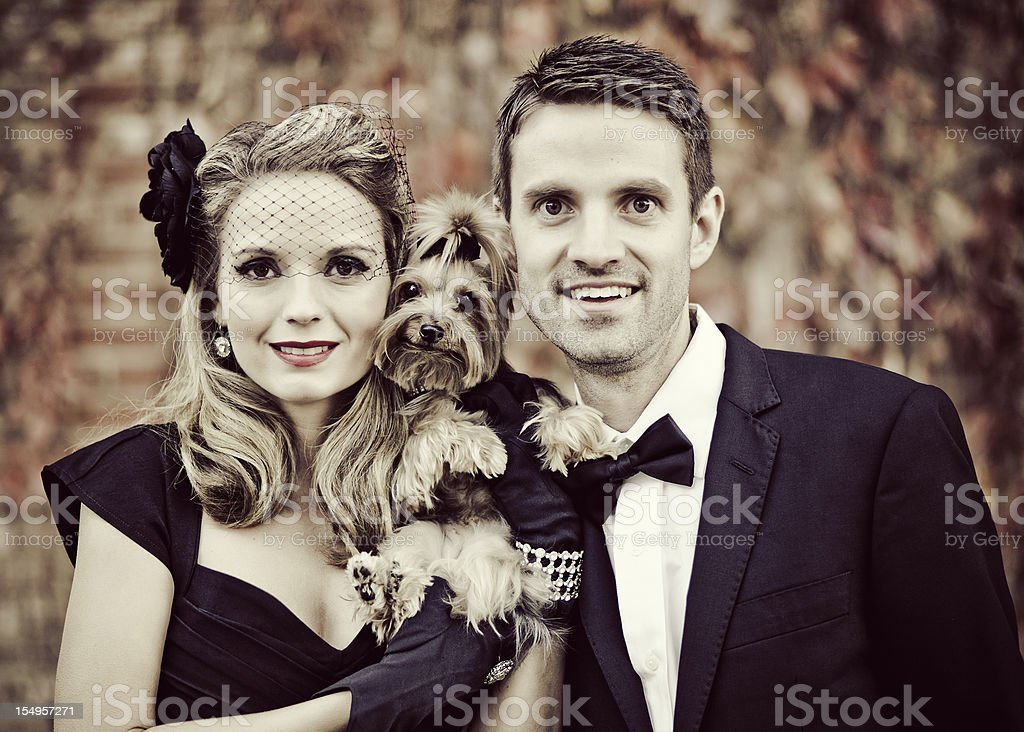 Vintage Woman and Man with Yorkshire Terrier stock photo