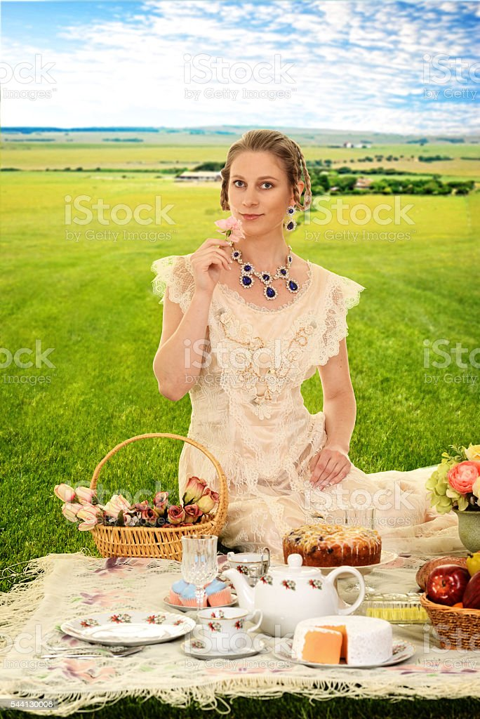 vintage woman at picnic with roses stock photo