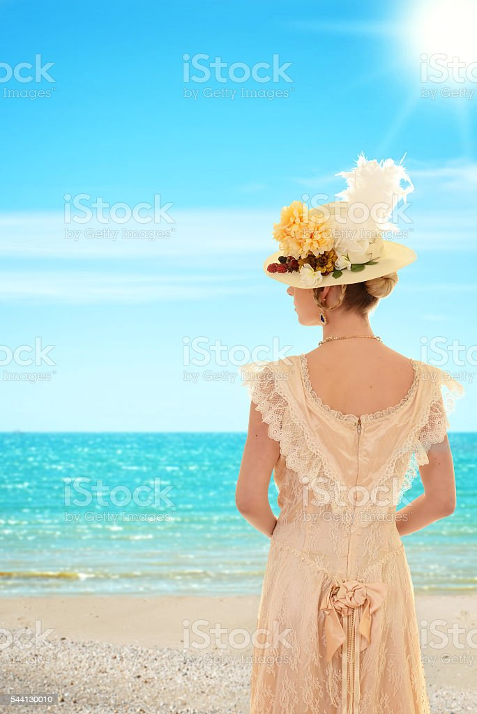 Vintage woman at the beach stock photo