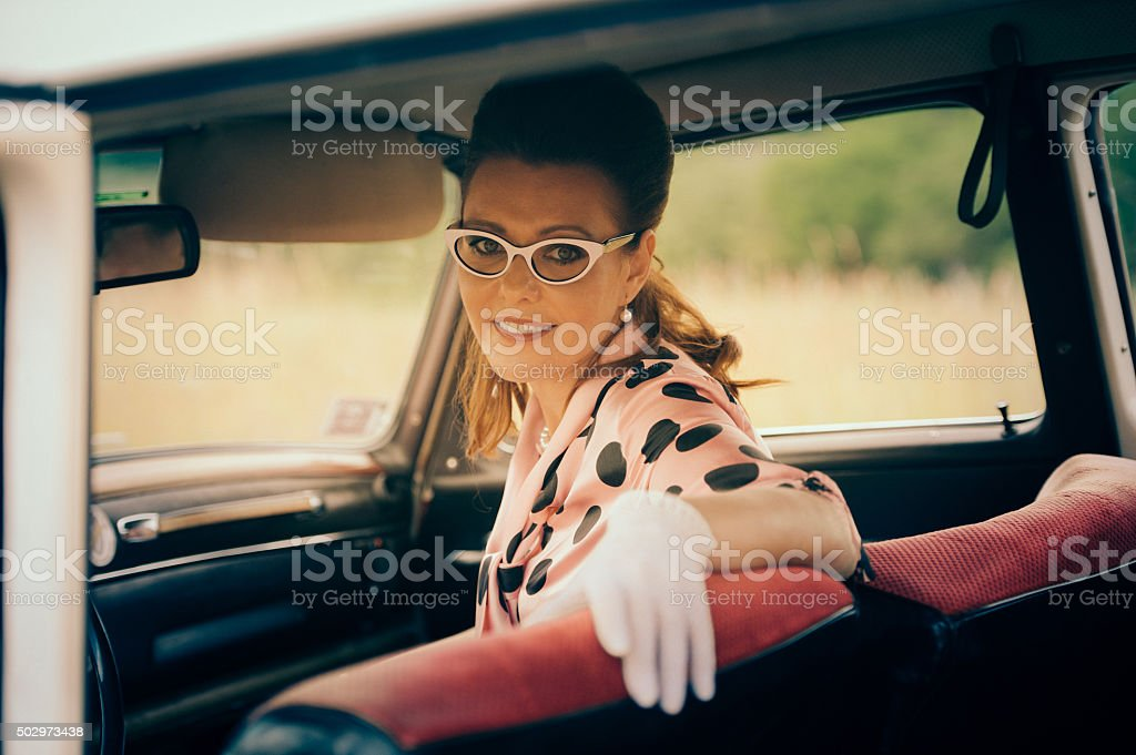 Vintage Woman Portret in an Old Car stock photo