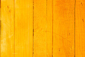 vintage wood background texture with knots and nail holes.