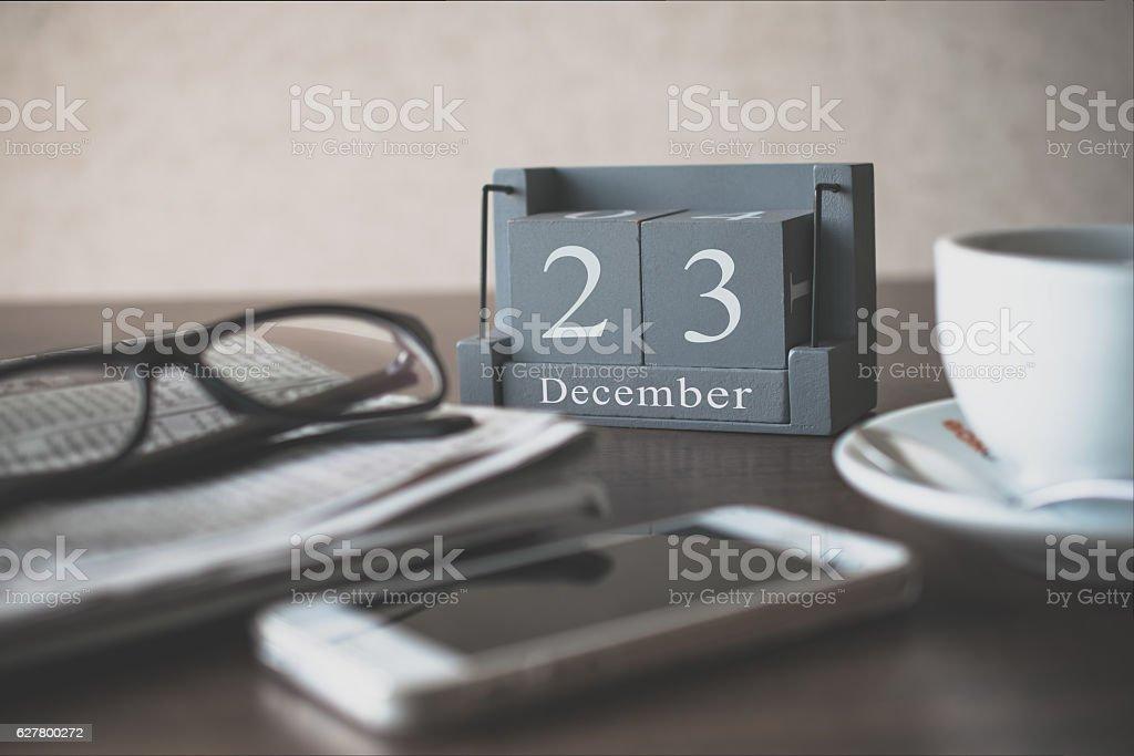 vintage wood calendar for December day 23 on office desk stock photo