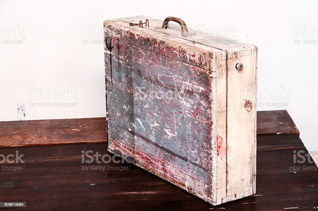 Vintage Wood Colored Brown Suitcase stock photo