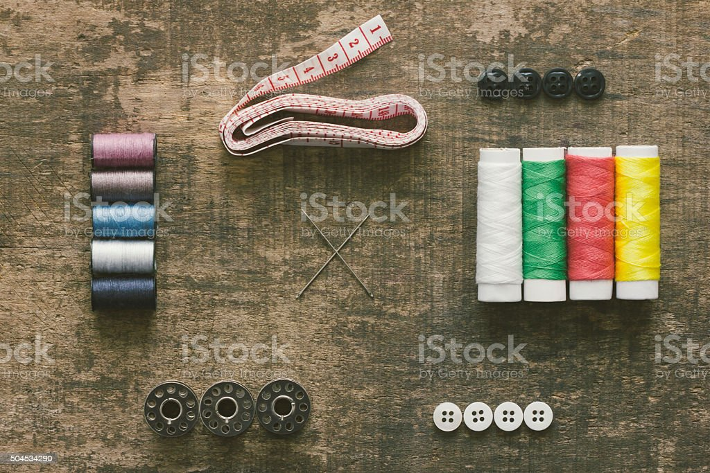 Vintage wood table with tailor equipment stock photo