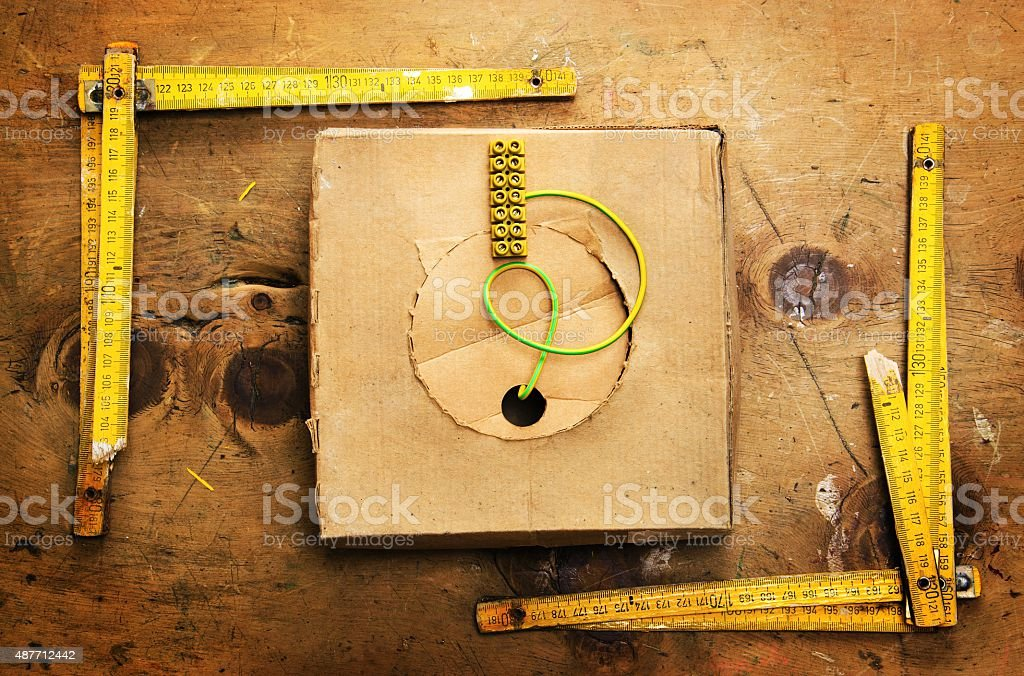 Vintage wood table with two yardsticks and wire stock photo