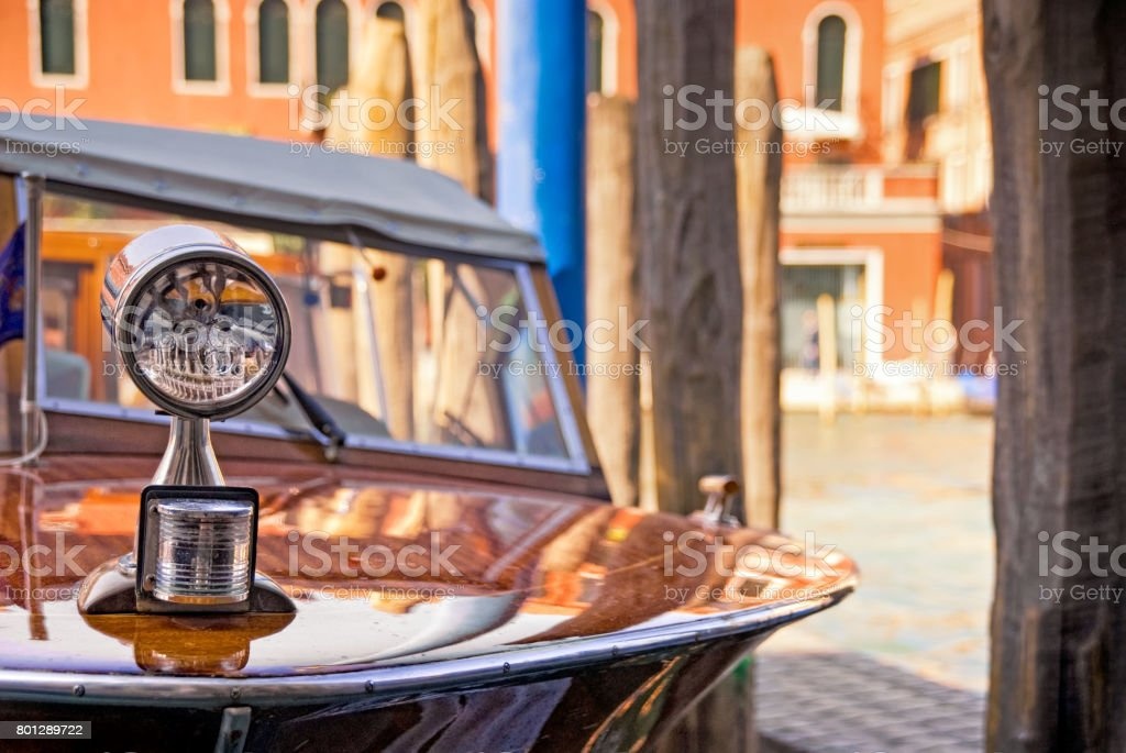 Vintage wooden 1960s speedboat in the Grand Canal, Venice, Italy stock photo