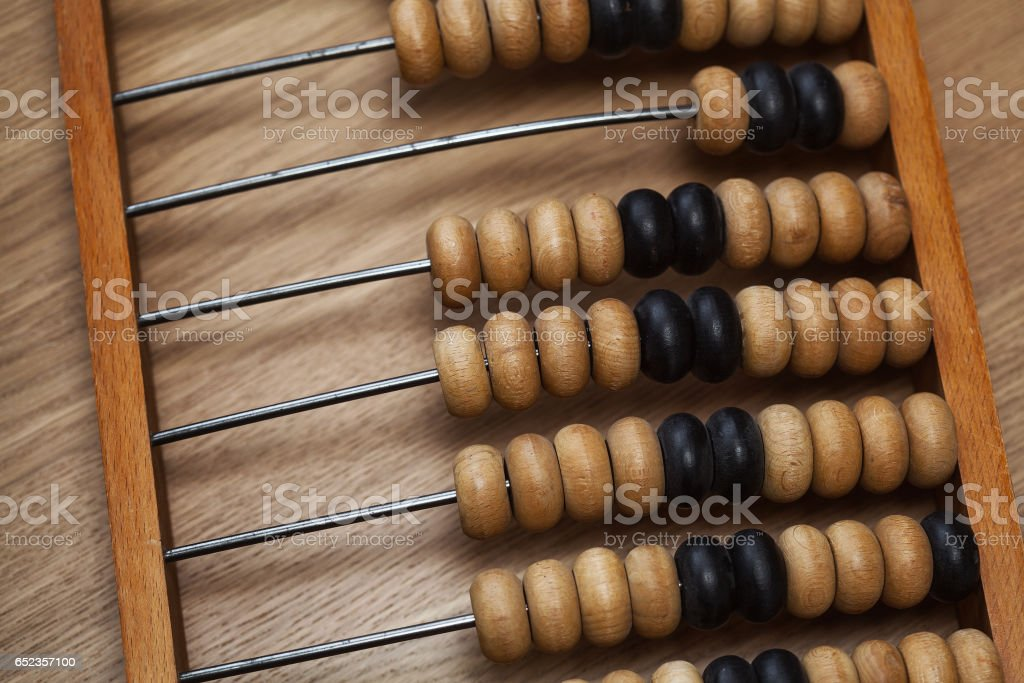 Vintage wooden abacus on the table stock photo