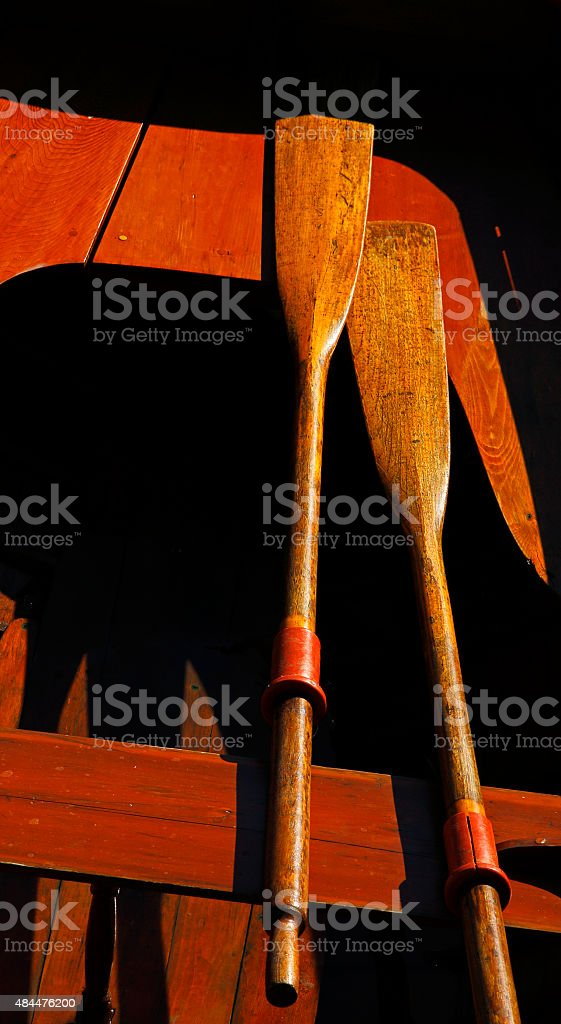 Vintage Wooden Boat Sun Paddles stock photo