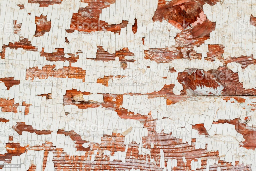 Vintage wooden brown textured background with peeling paint white color stock photo