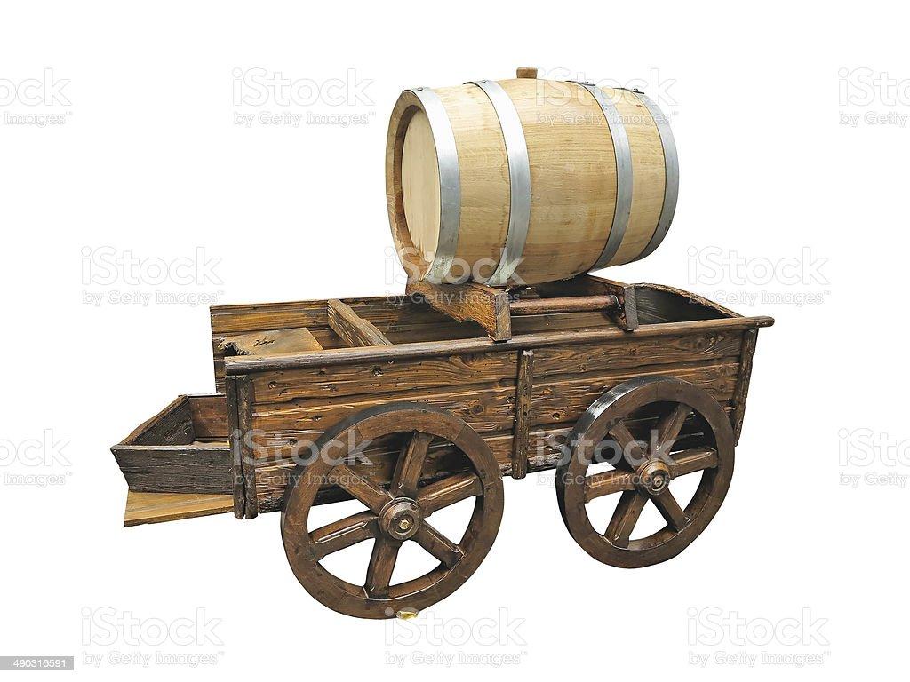Carrinho de madeira Vintage com vinho cilindro isolado sobre o branco foto de stock royalty-free
