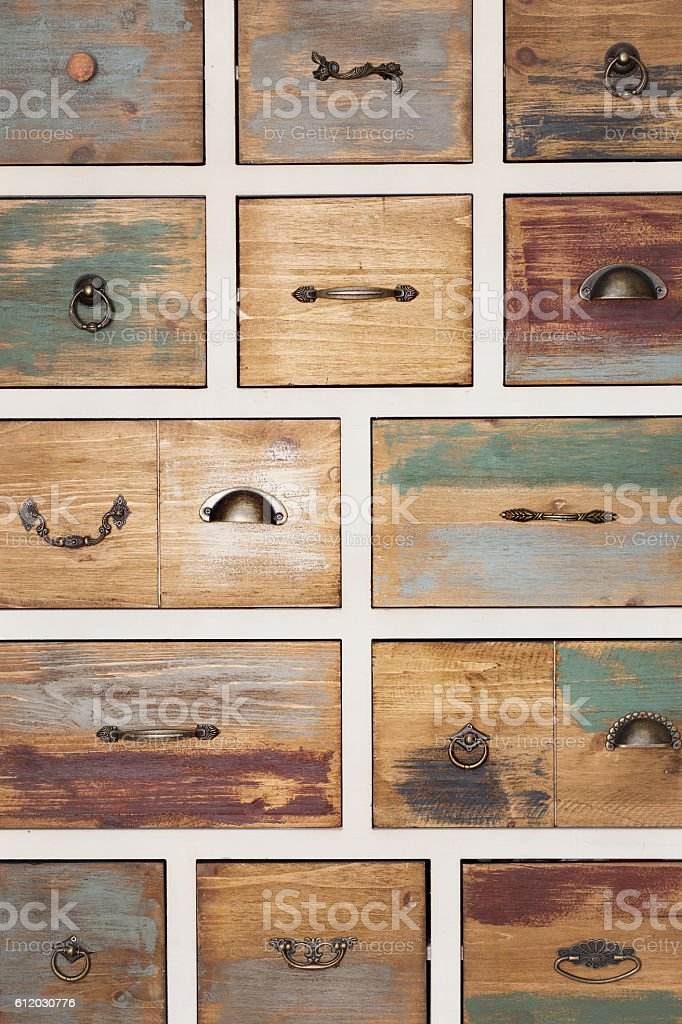 Vintage wooden chest of drawers with different handles stock photo