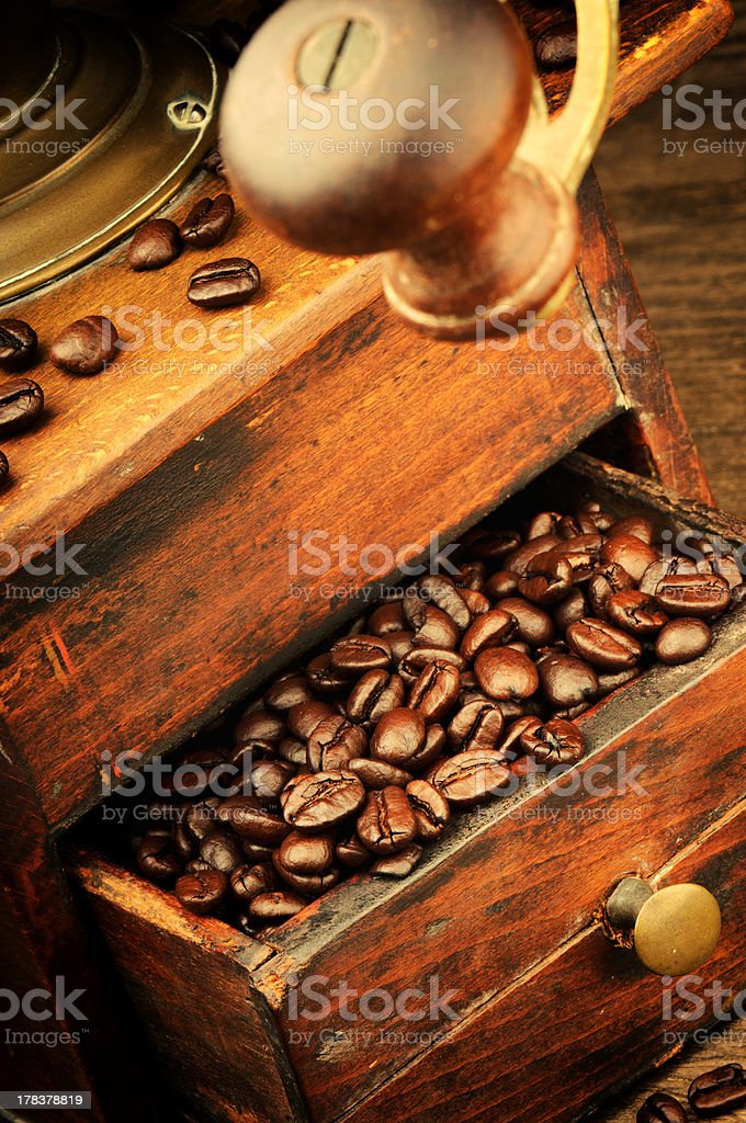 Vintage wooden coffee mill grinder stock photo