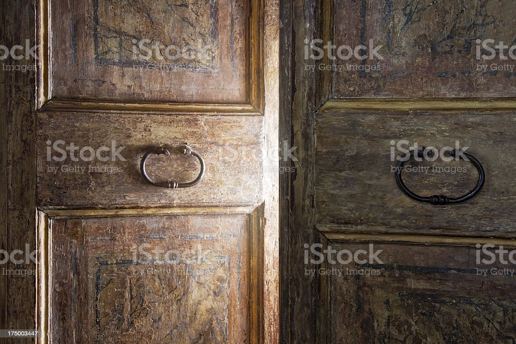 A vintage wooden door with a circular handle stock photo