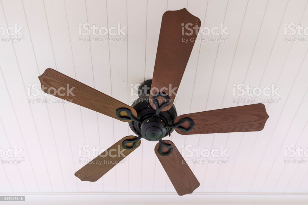 Vintage wooden fan hang on ceiling stock photo