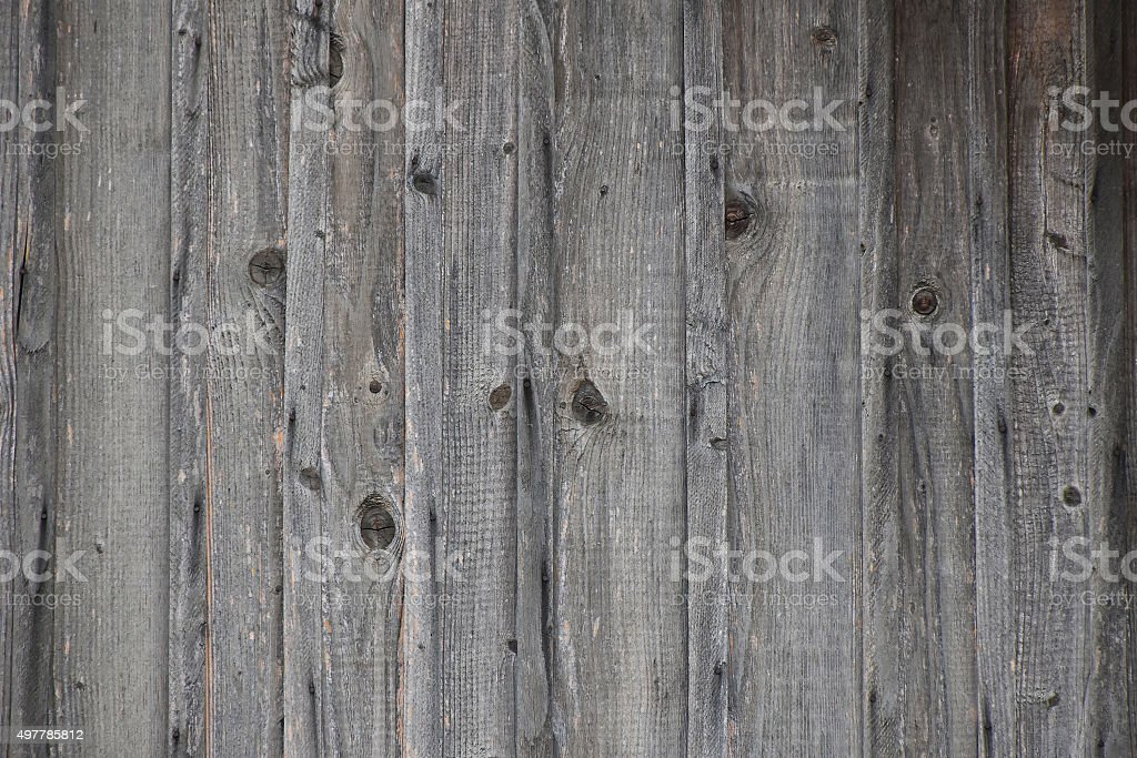 Vintage wooden fence with vertical planks and gaps royalty-free stock photo