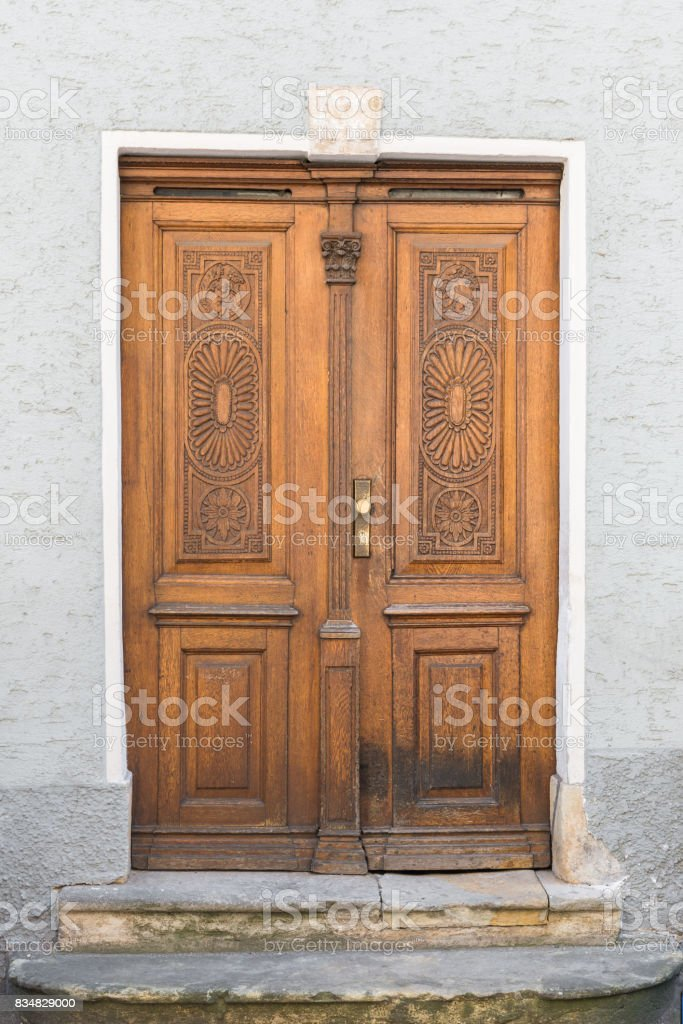 Vintage wooden front door, Regensburg, Germany stock photo