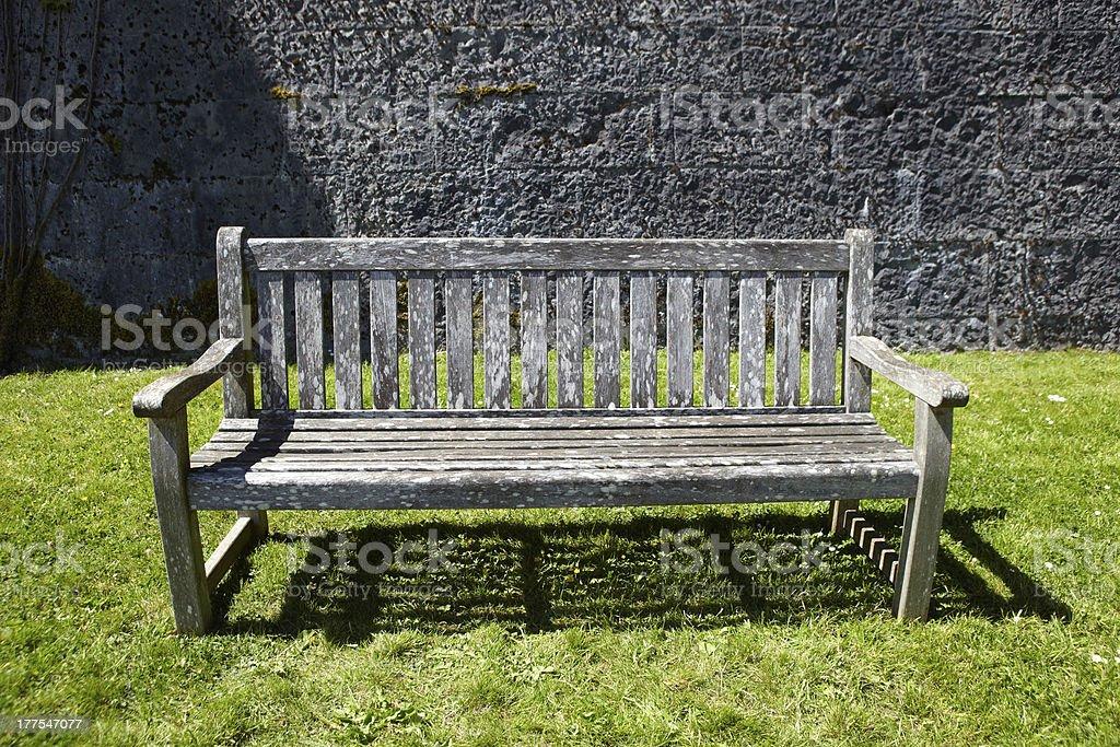 Vintage wooden garden bench royalty-free stock photo