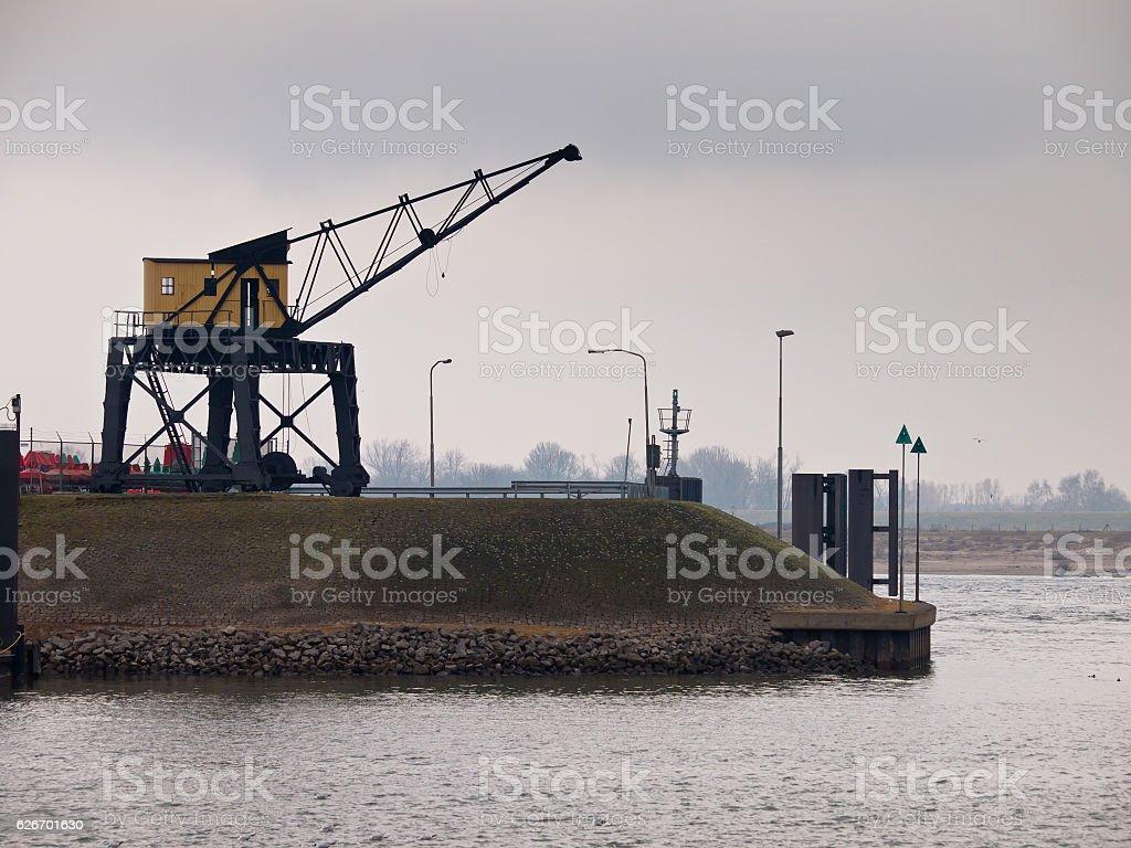 Vintage wooden harbor crane stock photo