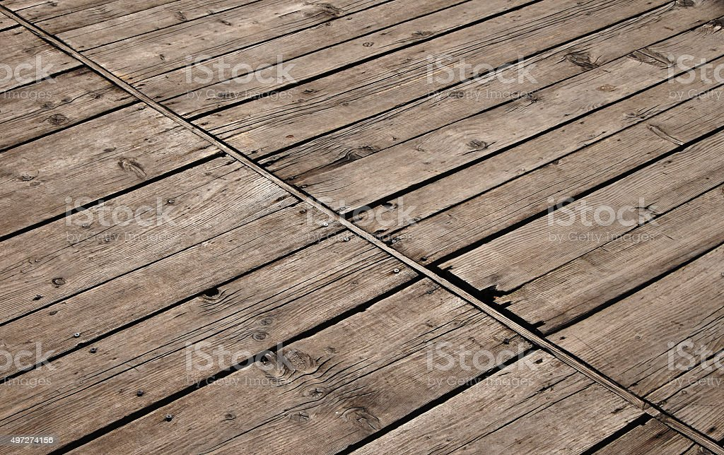 Vintage wooden panel with diagonal planks and gaps royalty-free stock photo