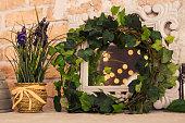 vintage wooden rectangular white frame with green plant. Floral scene.