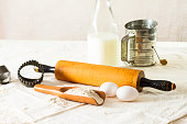 Vintage Wooden Rolling Pin Resting On An Old Kitchen Cloth
