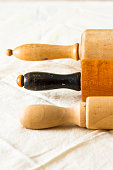 Vintage Wooden Rolling Pins On An Old Kitchen Cloth