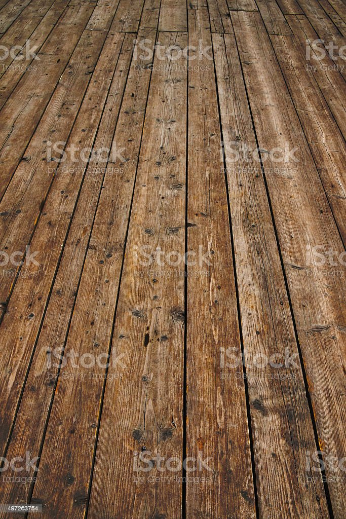 Vintage wooden surface with planks and gaps in perspective royalty-free stock photo