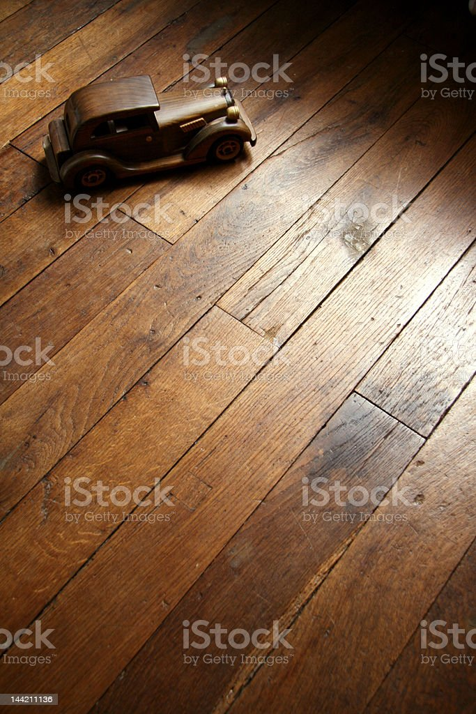 Vintage wooden toy car on wooden style parquet flooring  stock photo