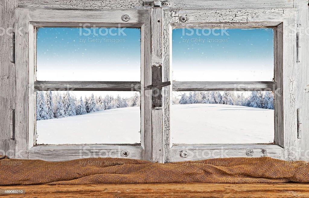 Vintage wooden window overlook winter landscape stock photo