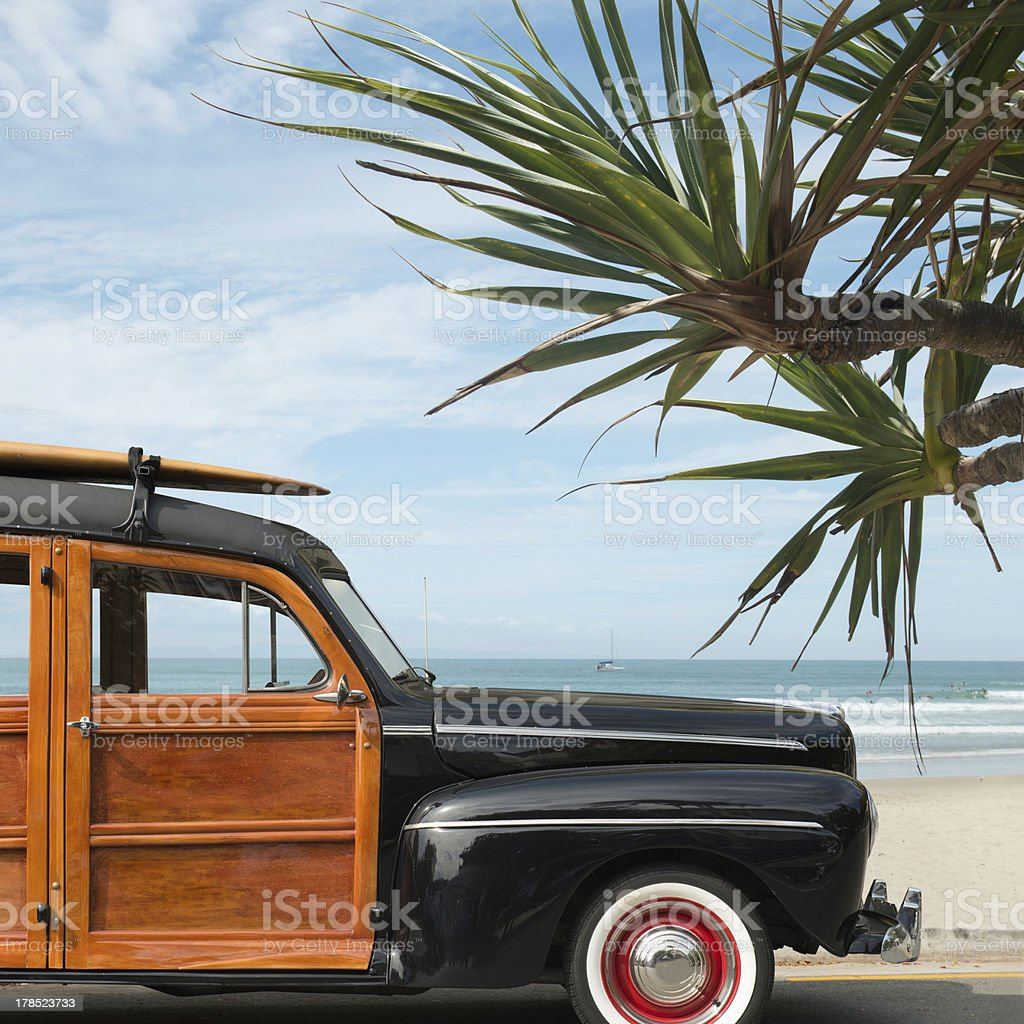 vintage woodie car on beach stock photo