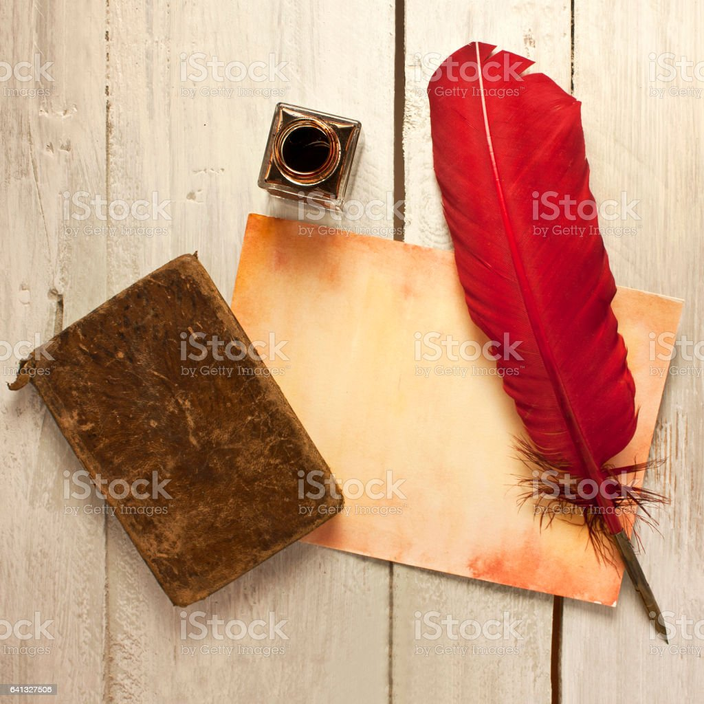 Vintage writing: aged paper, quill pen, bottle of ink stock photo