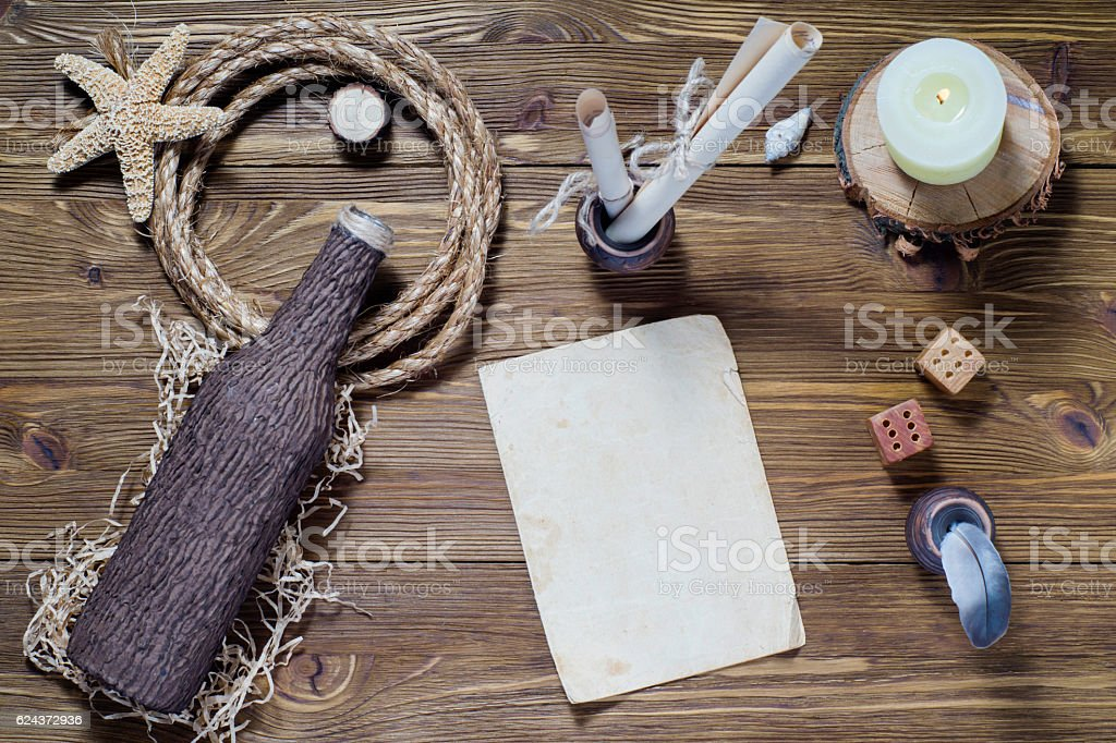Vintage writing set, feather quill, ink, desk and blank paper stock photo