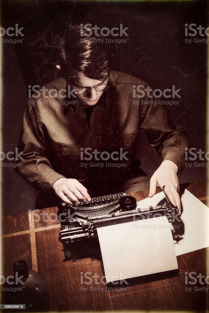 Vintage WWII American Soldier Sitting At His Typewritter Typing stock photo
