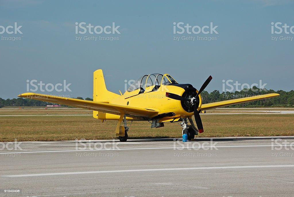 Vintage yellow airplane on the ground royalty-free stock photo