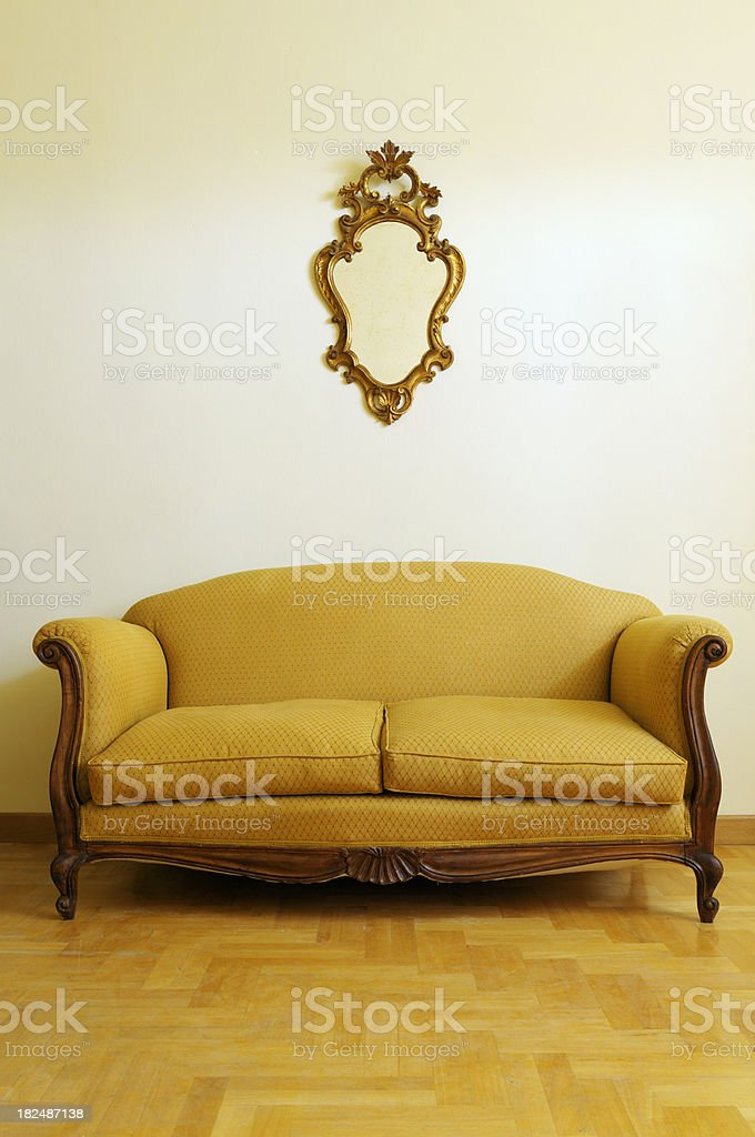 Vintage Yellow Sofa and Gold Mirror royalty-free stock photo