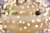 vintage yellow toned bokeh with blurred sparkling christmas lighting