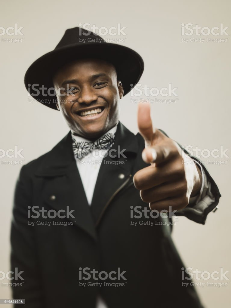 Vintage young man pointing at you and smiling stock photo