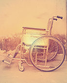 Vintage,Old Wheelchairs with wall background