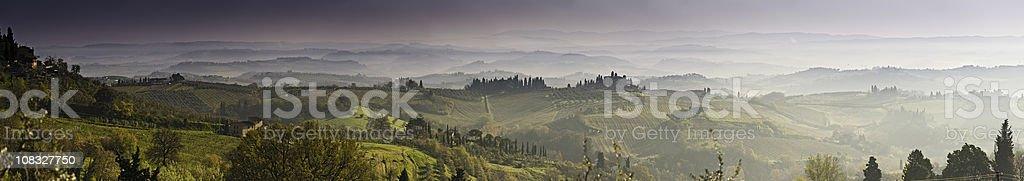 Vinyards villages misty valleys cypress trees San Gimignano Tuscany Italy royalty-free stock photo