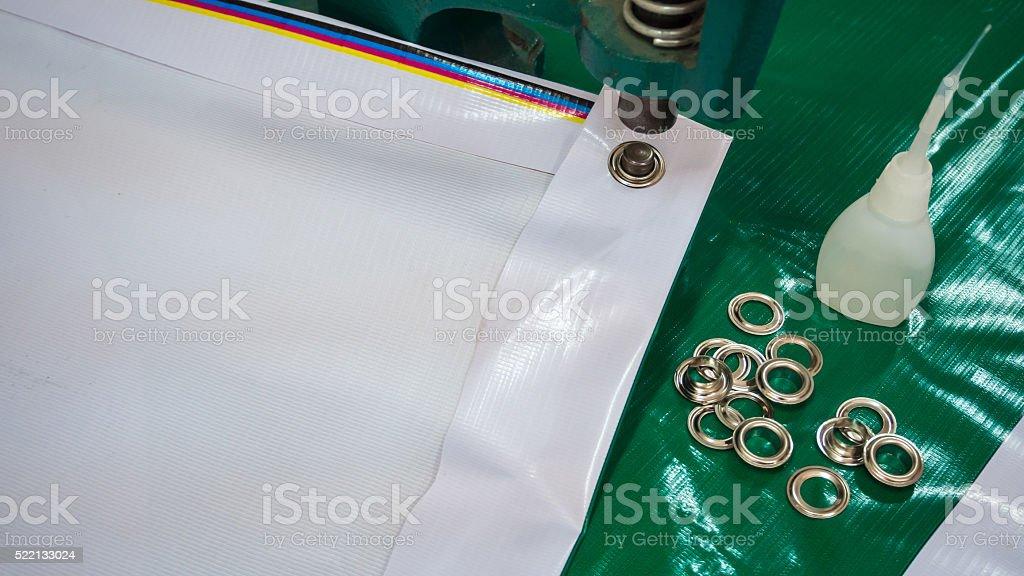 Vinyl banner border fold with eyelet pupmer and glue stock photo