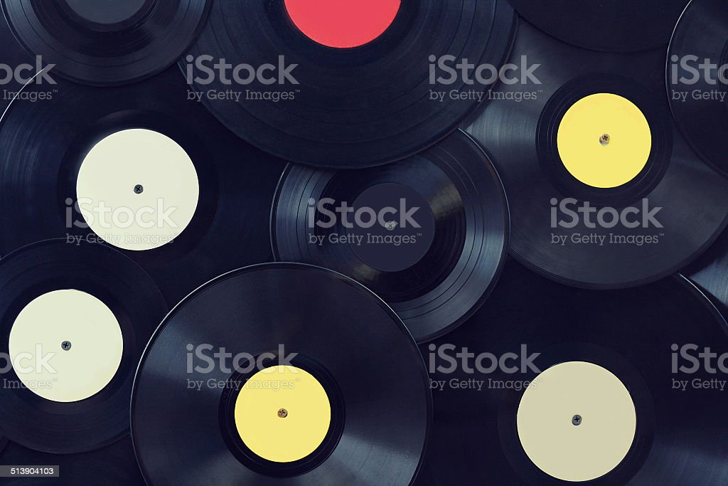 Vinyl disks wall, vintage musical background stock photo