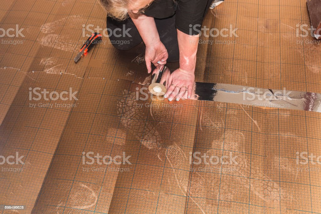 Vinyl laminate laying in old building stock photo