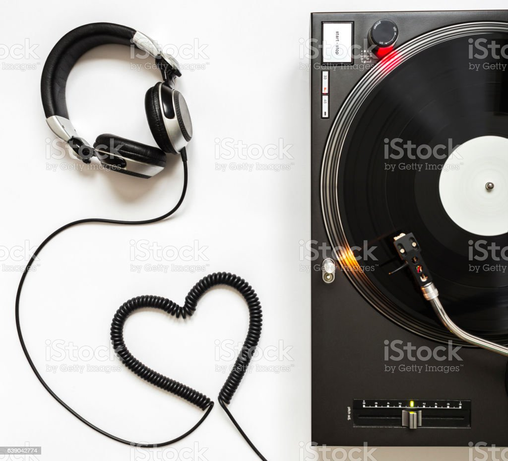 Vinyl Player with Headphones and Cord Shaped of Heart stock photo