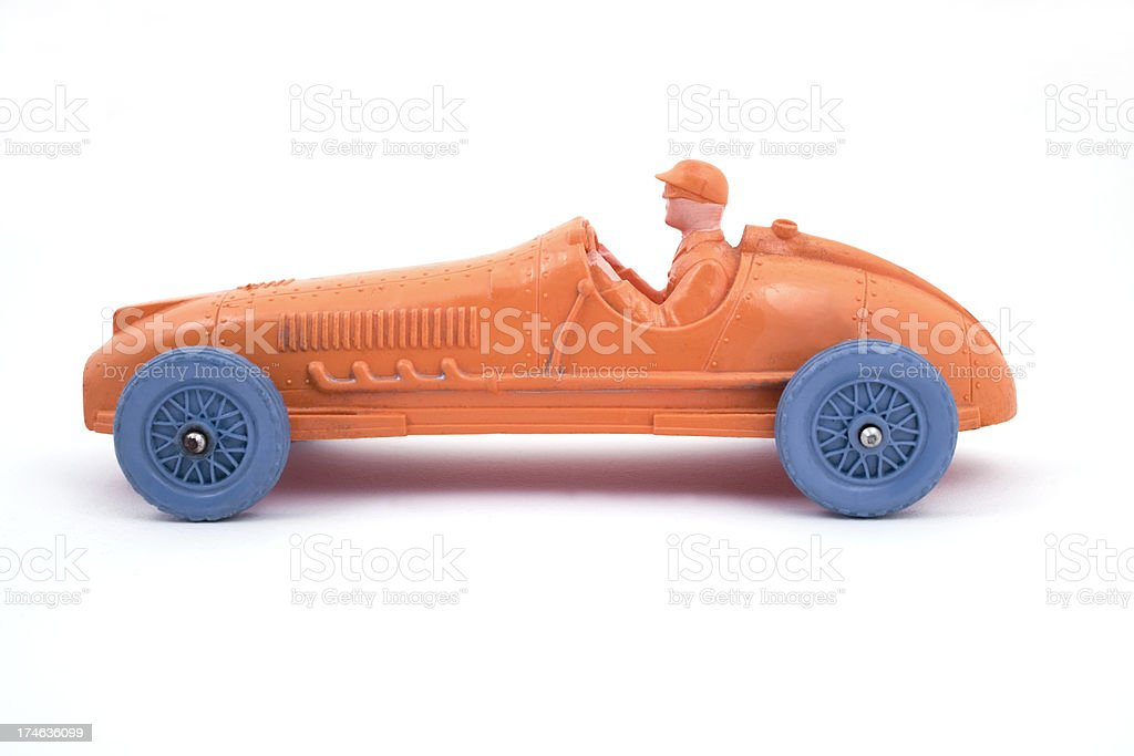 Vinyl racing car with blue tires and motorist with cap. royalty-free stock photo