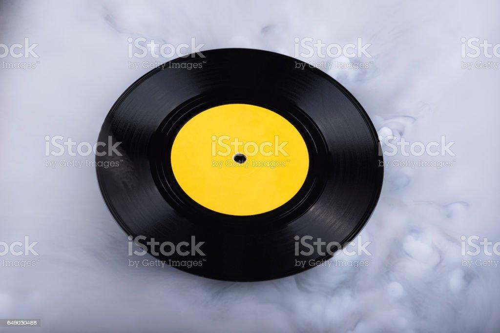 Vinyl record  in clouds. Conceptual image. Retro sound stock photo