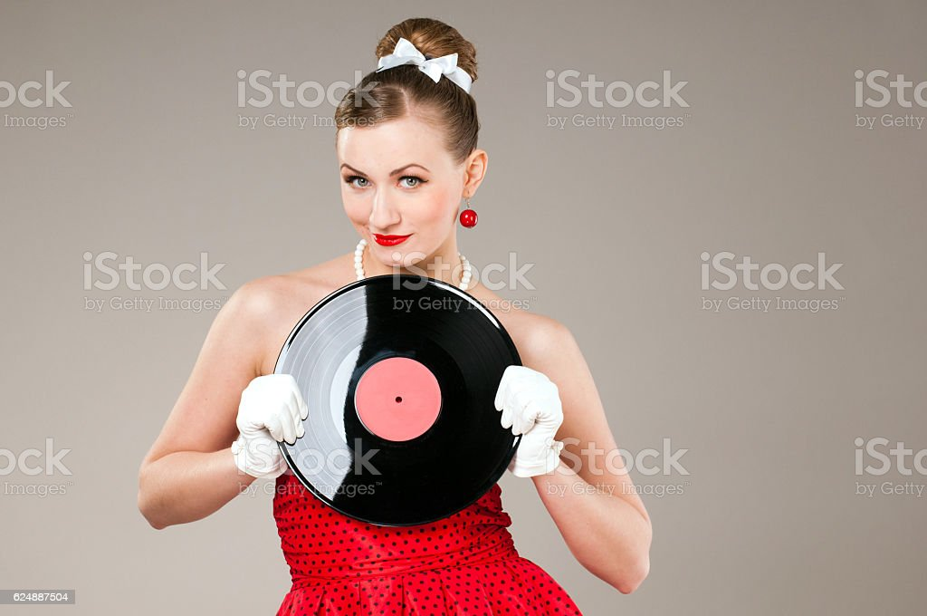 Vinyl record in the hands of women, good music, hits, stock photo