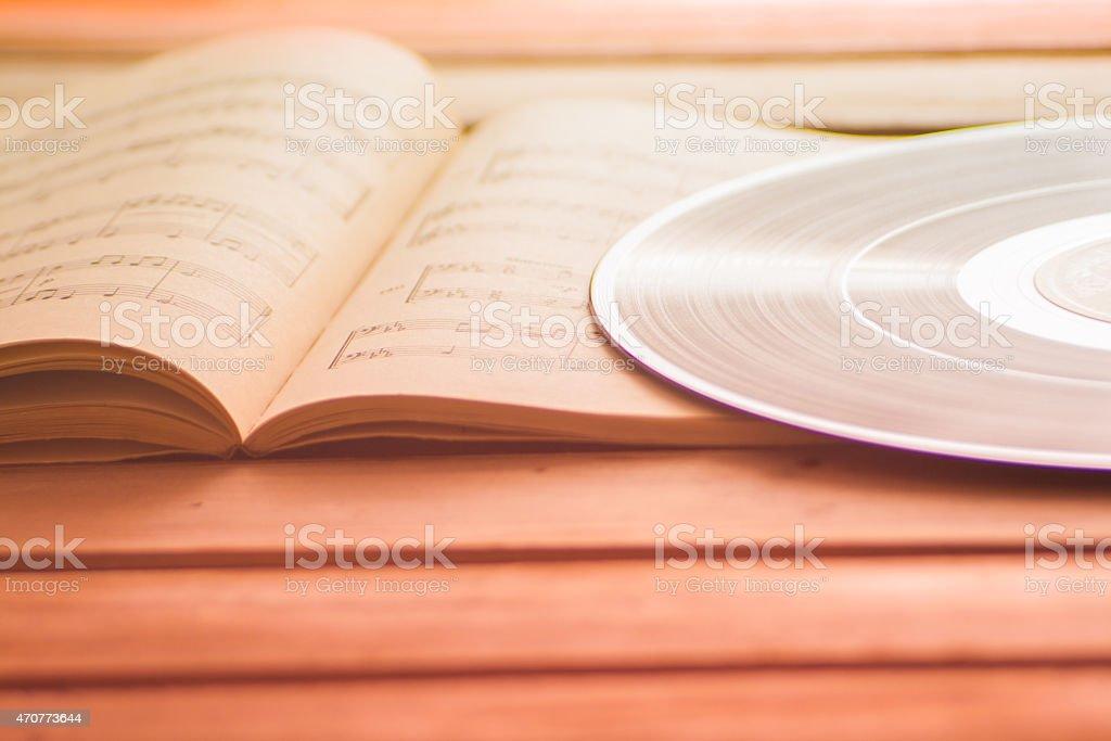 Vinyl record on music scores music background stock photo