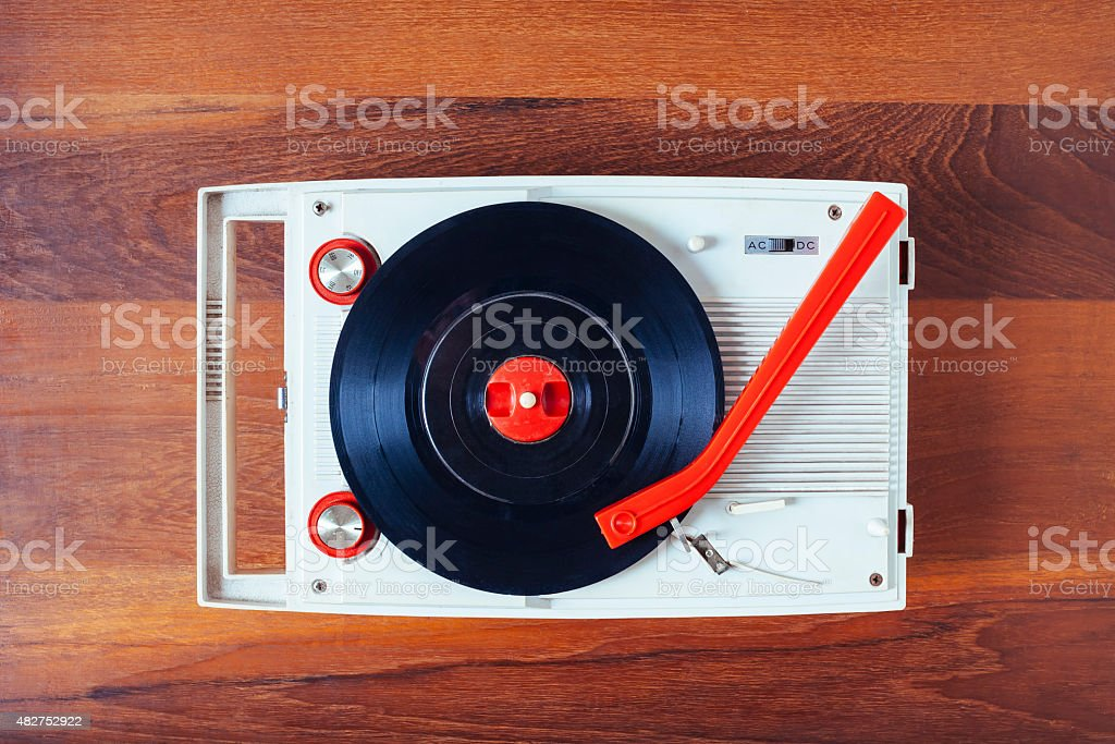 Vinyl record player Vintage retro object on wooden background stock photo