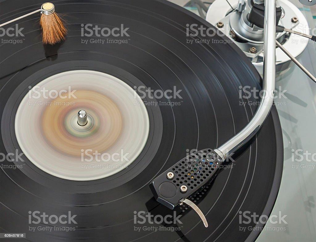 Vinyl record spinning on turntable stock photo